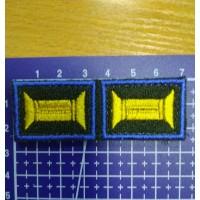 Знак принадлежности к офицерскому званию оливковый желтый с голубым кантом на липучке